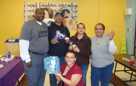 Stephanie Garcia'13 (center) presents custodians with a trophy in their honor.